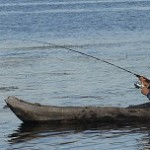 fishing-from-stone-age-canoe